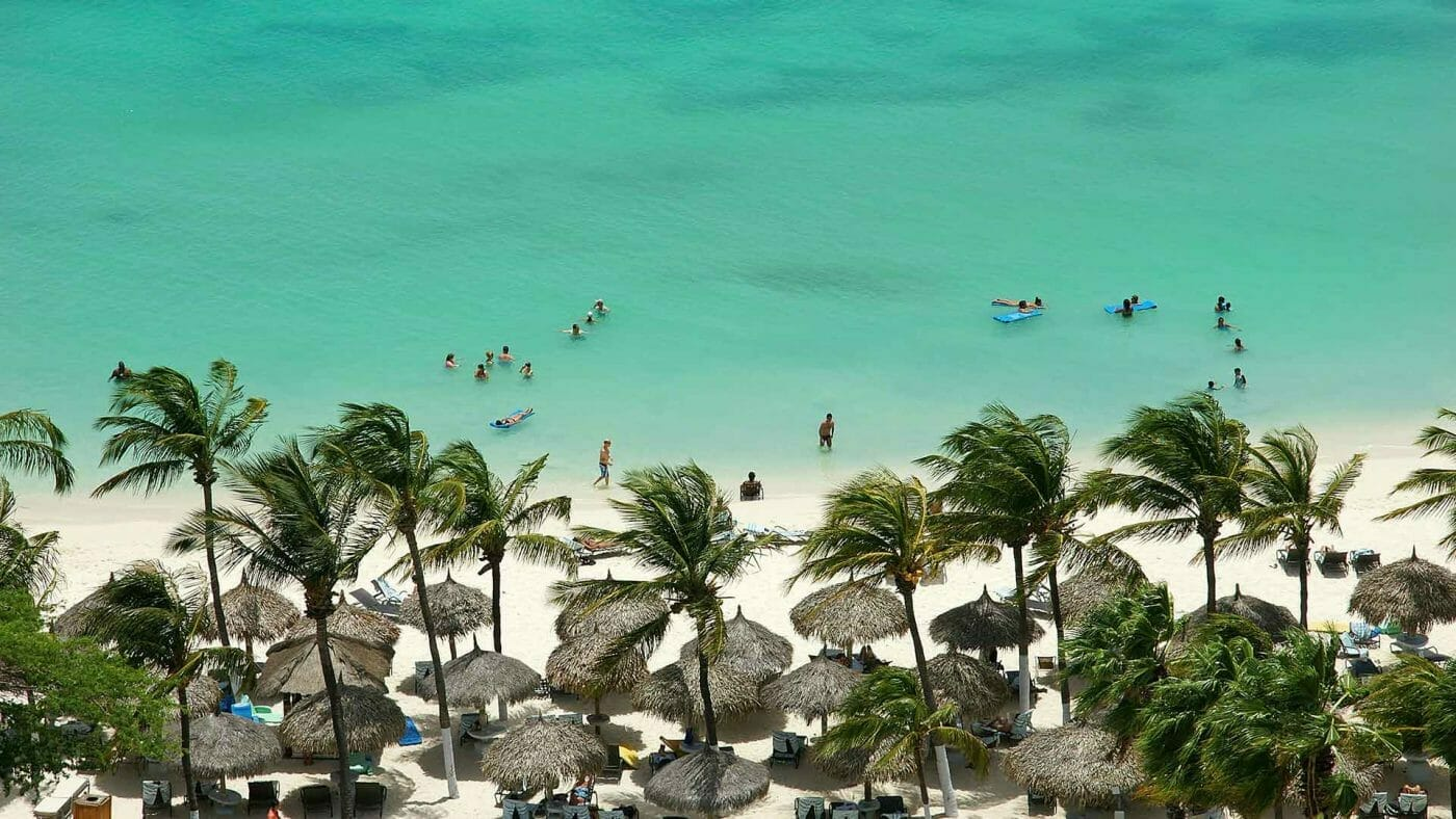 mexico beach with people swimming wallpaper
